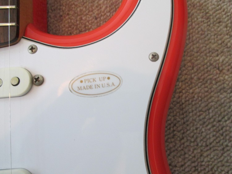 Red JV Squier oval sticker